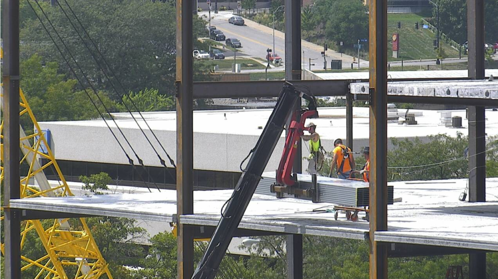 Kinzler crews unload steel framing into the building.