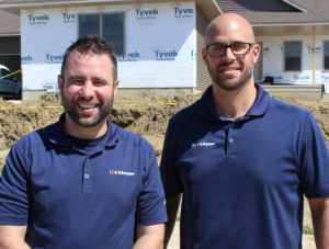 Kinzler Construction Services is already operating crews out of their new Cedar Rapids location. Pictured at a local jobsite is General Manager Craig Coder (left) and Sales Representative Nick Hlas (right).
