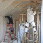 Kinzler installers install spray foam insulation into wall cavaties to make Ben Cordero's home air tight.