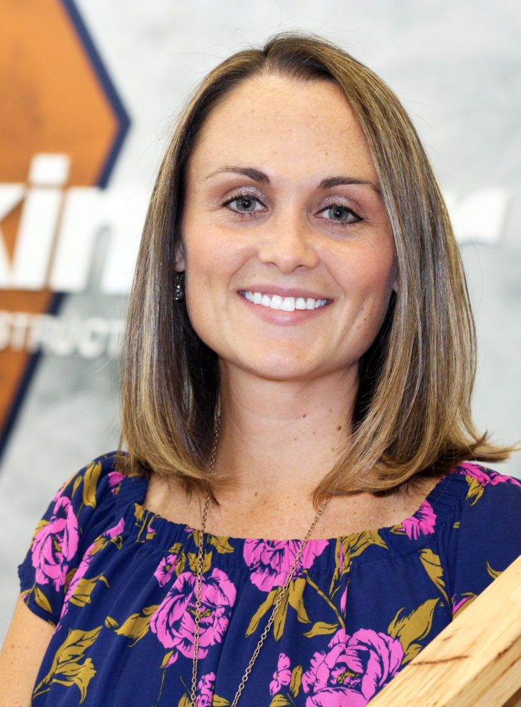 Breanne Kruger, in the Hearth Room at Kinzler's Branch Support Headquarters, is the company's new Chief Financial Officer.