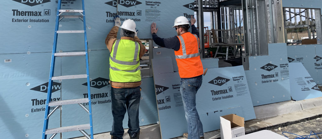 Expert installers from Kinzler Construction Services install CI on a new construction project.